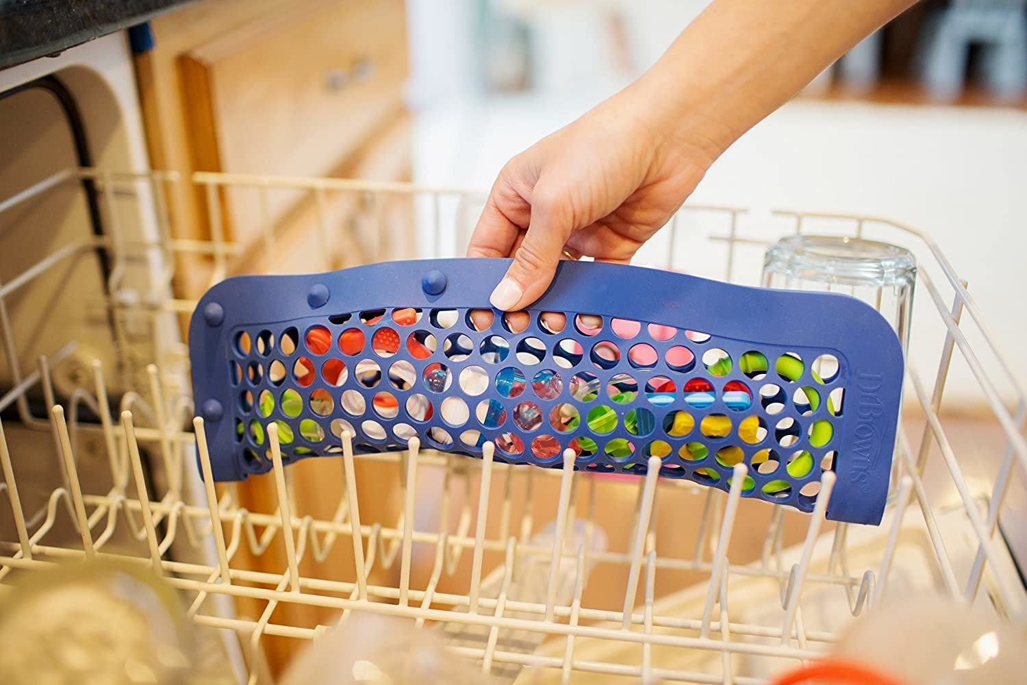 A person places the silicone bag into a dishwasher