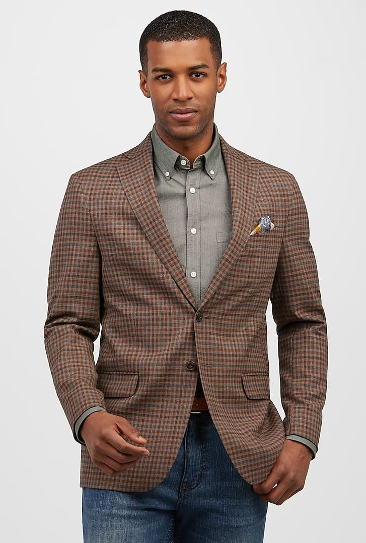 Model wearing multi-colored sportcoat over jeans