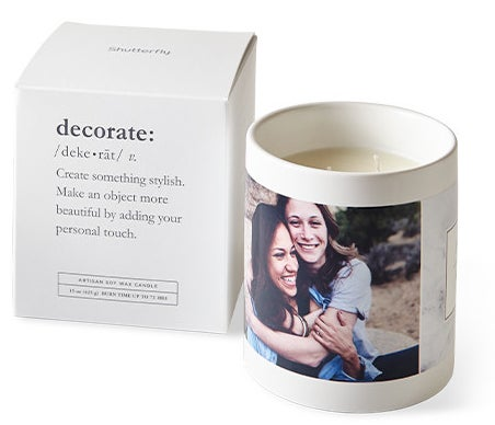 Candle with two wicks and photos on outside cup