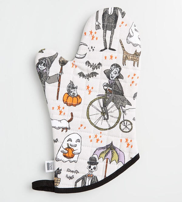 The white oven mitt with a Halloween-themed print on it