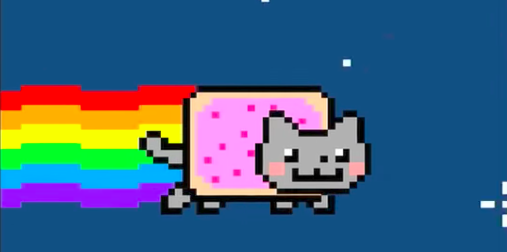A pop-tart/cat hybrid flying through the sky with a rainbow trailing behind it