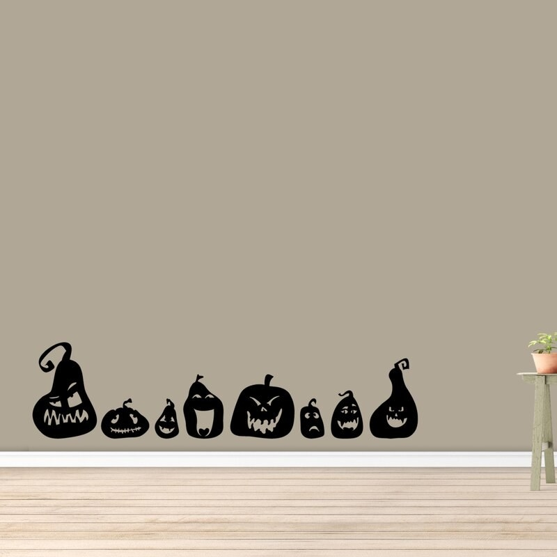 The pumpkin wall decal placed on a living room wall