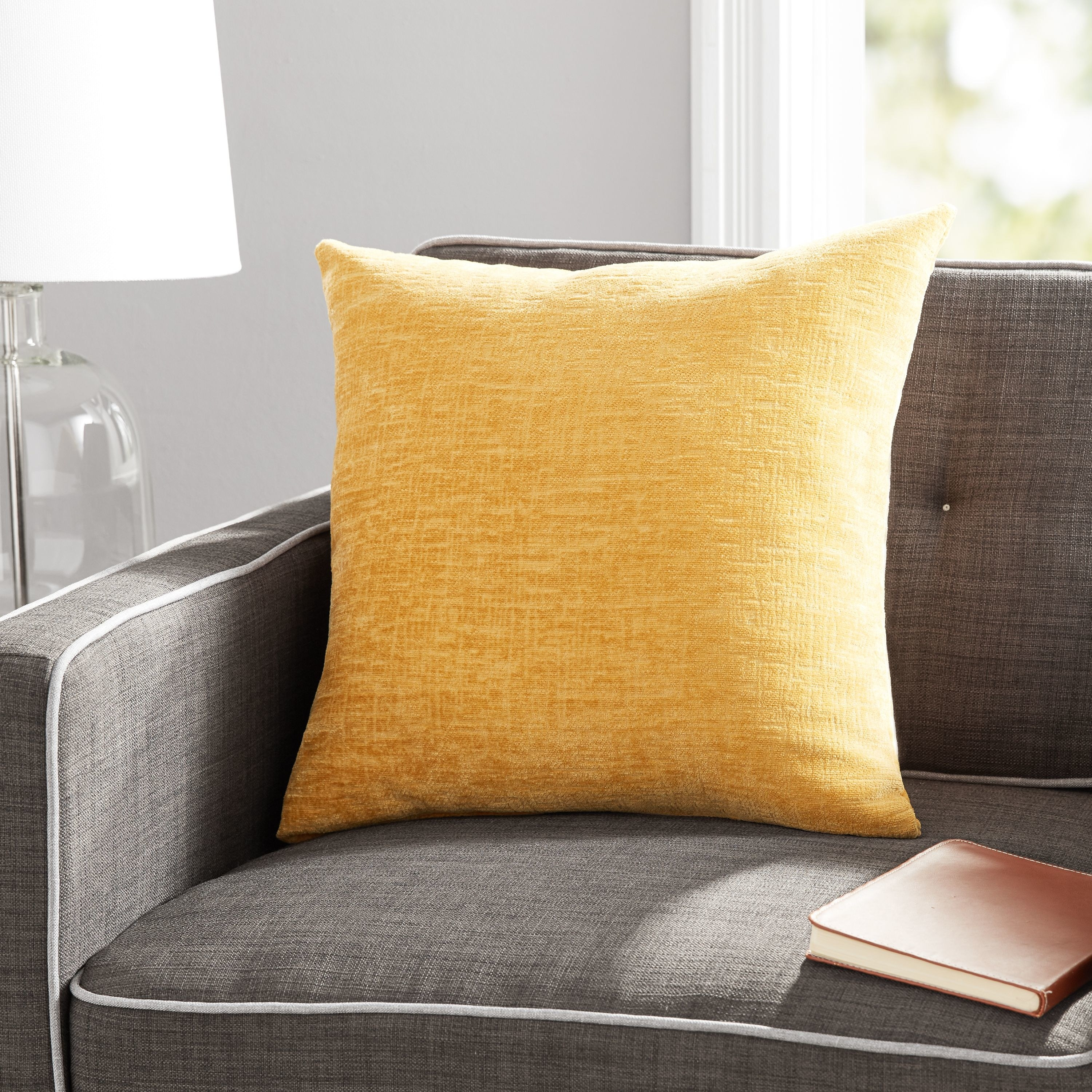 The textured pillow in yellow