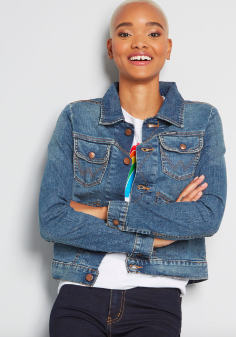 Model wears blue Wrangler x MC Dependable Denim Jacket with dark blue jeans and a white T-shirt