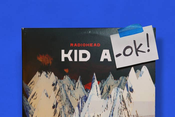 """The album """"Kid A"""" by Radiohead has a note that adds a suffix """"OK!"""" after the title, reading """"Kid A-OK!"""""""