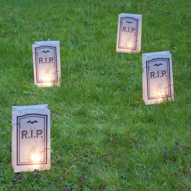 Four of the tombstone lights lit up in a yard