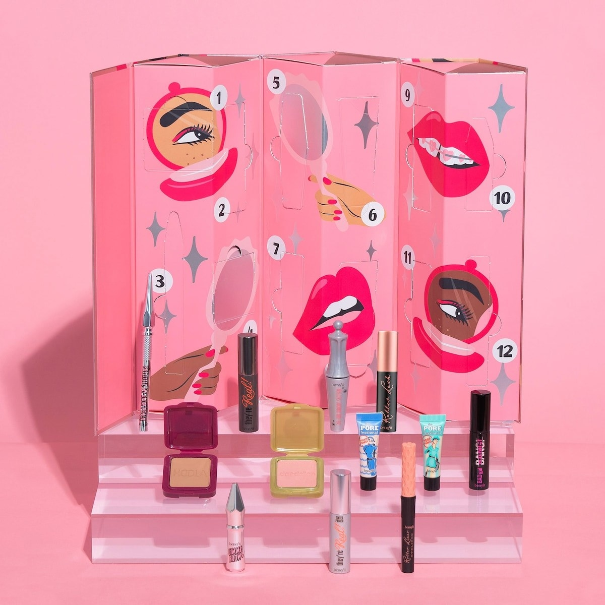 a pink fold out piece of cardboard with 12 flaps to reveal tiny beauty products