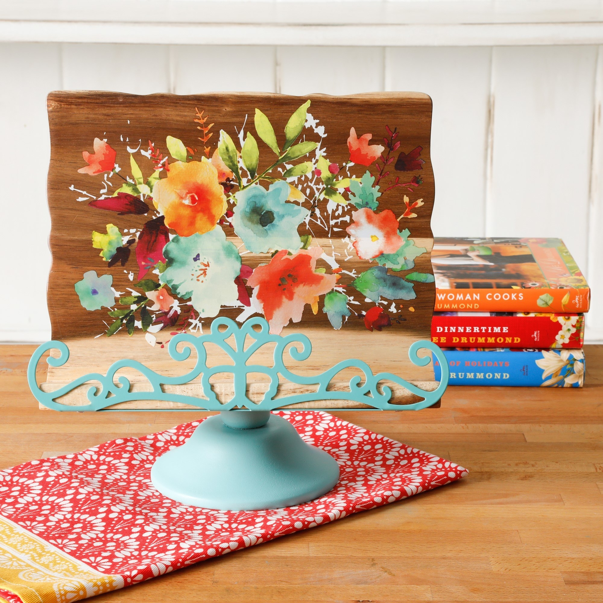 a cookbook holder with a floral print on it sitting on a kitchen counter