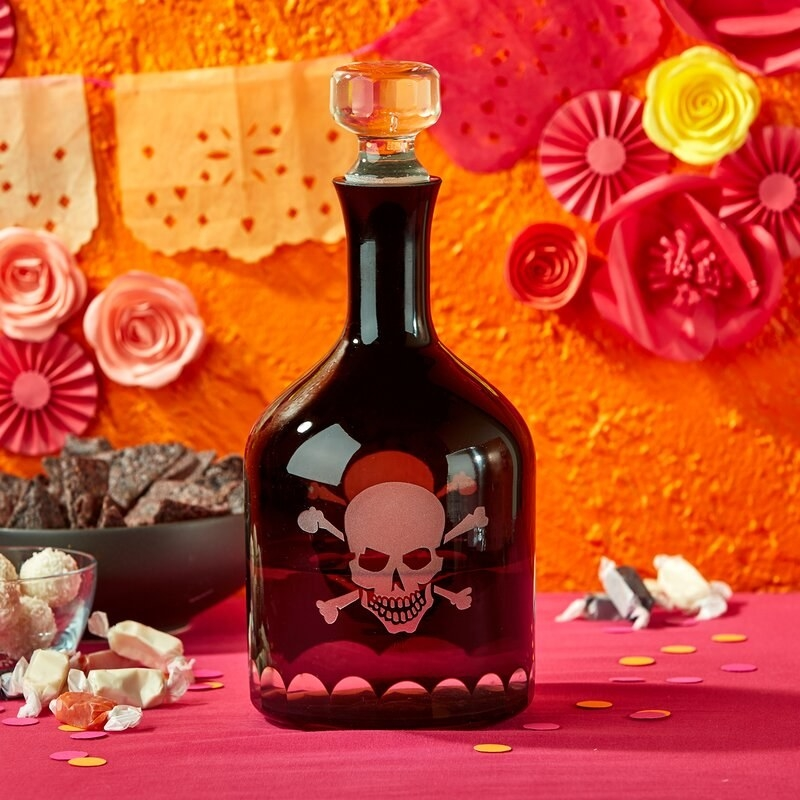 The whiskey decanter filled to show the skull and crossbones