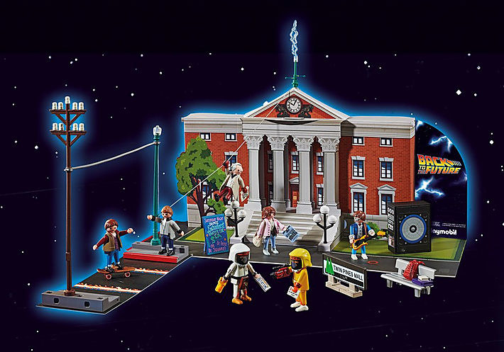 the cardboard back to the future advent calendar shaped like the town hall with various small figures around it
