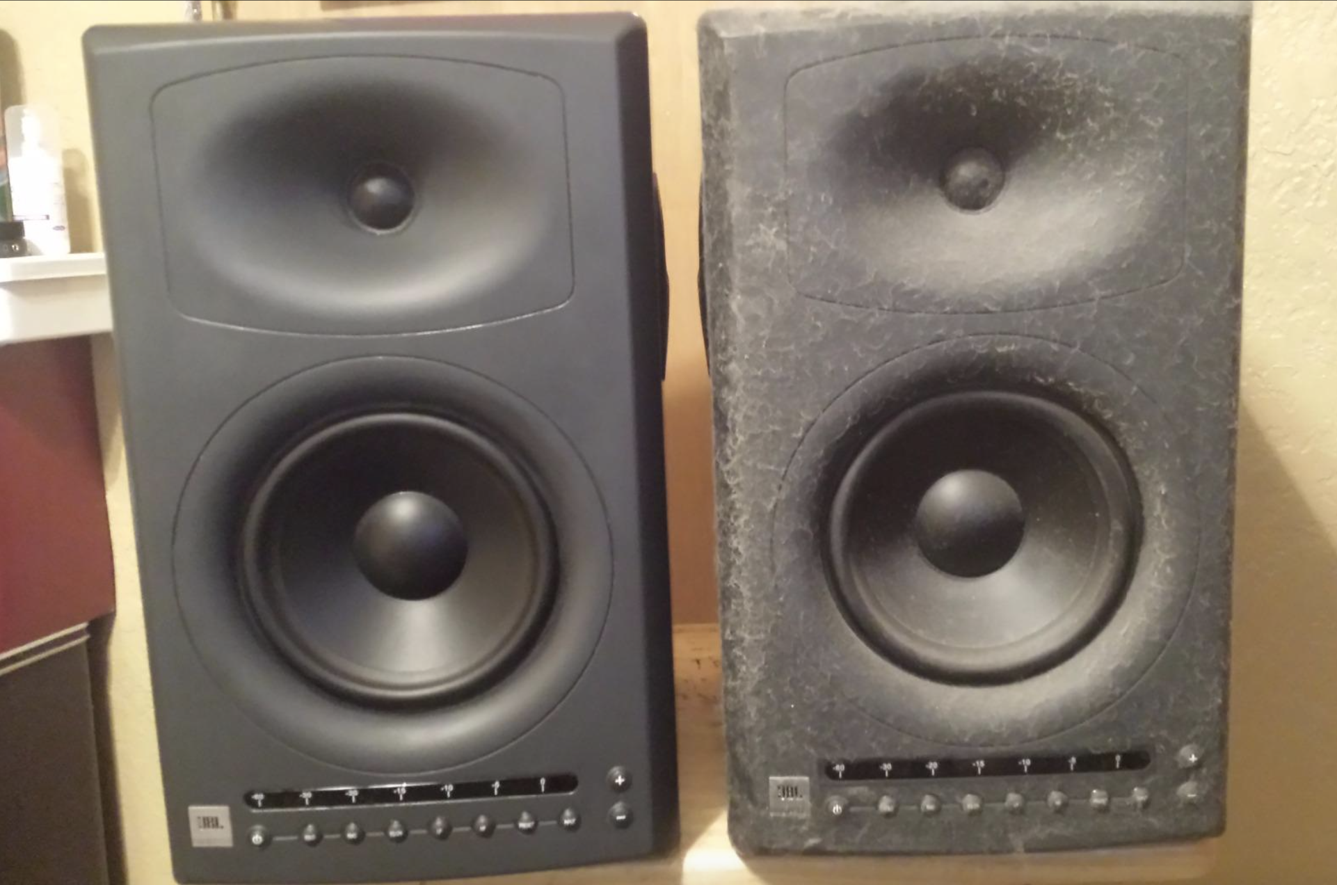 reviewer photo of speaker on left looking clean and speaker on right covered in adhesive