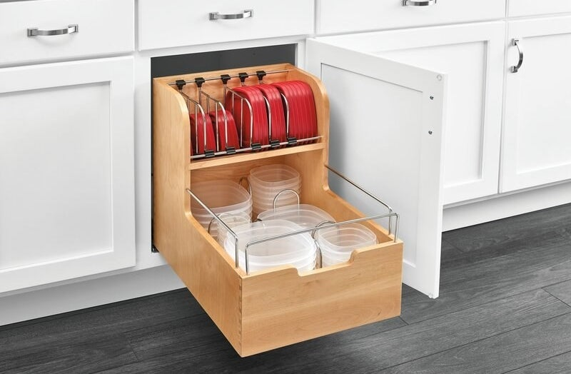 a two-tiered wooden pantry storage insert pulled out of a cabinet