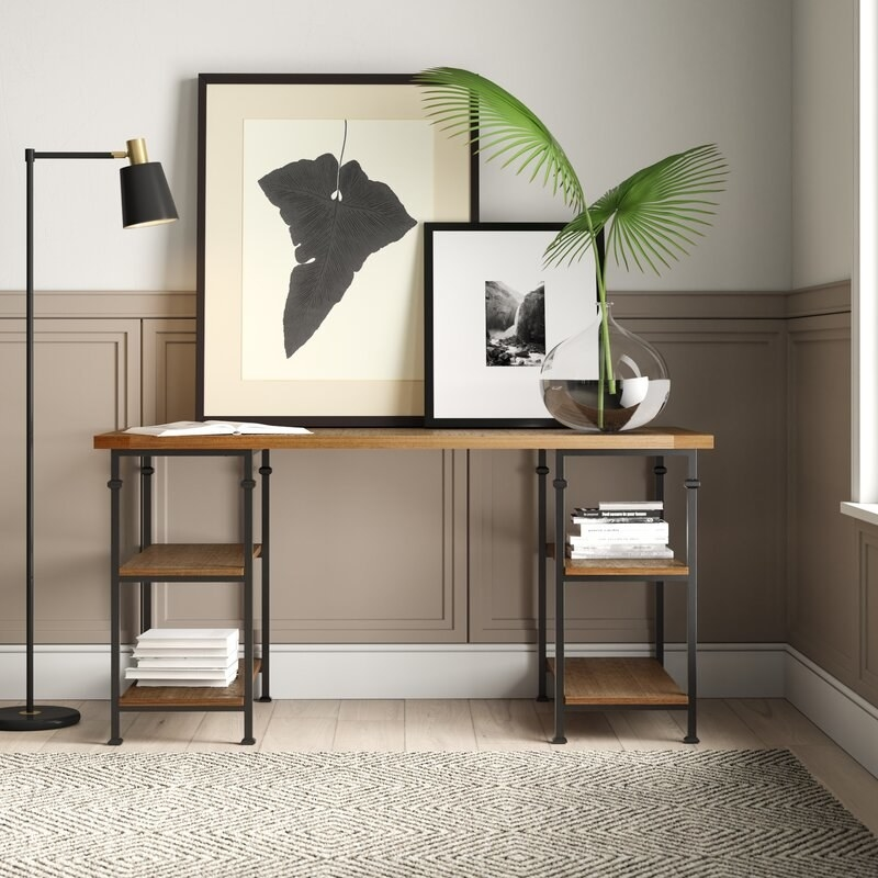 A wooden desk with metal legs and four shelves for storage