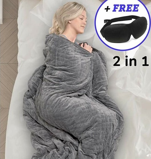 a model sleeping while wrapped up in a grey gravity blanket