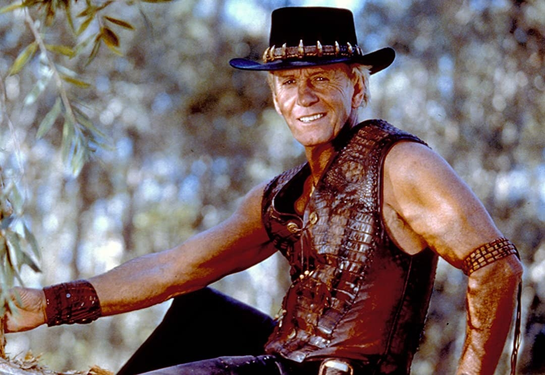 "Paul Hogan from ""Crocodile Dundee"" sitting down"