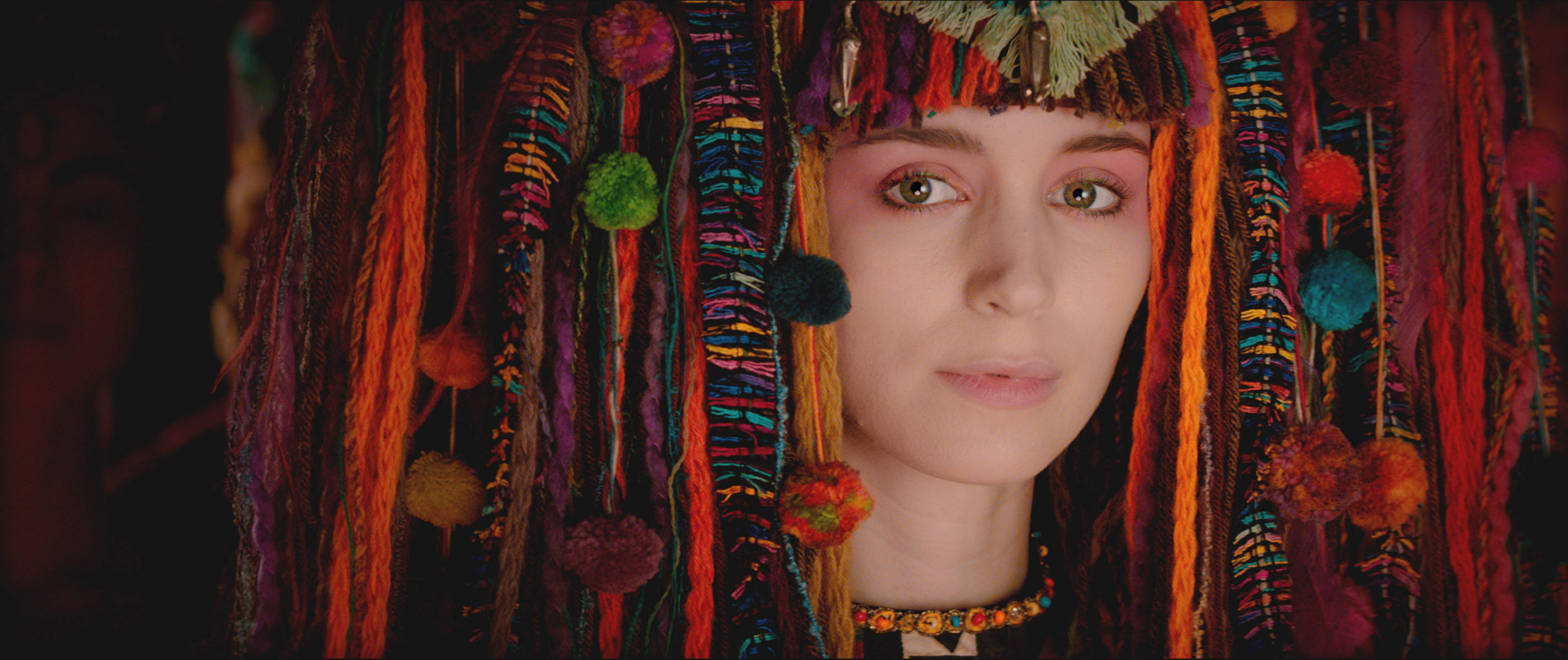 Rooney Mara as Tiger Lily wearing a traditional headdress.