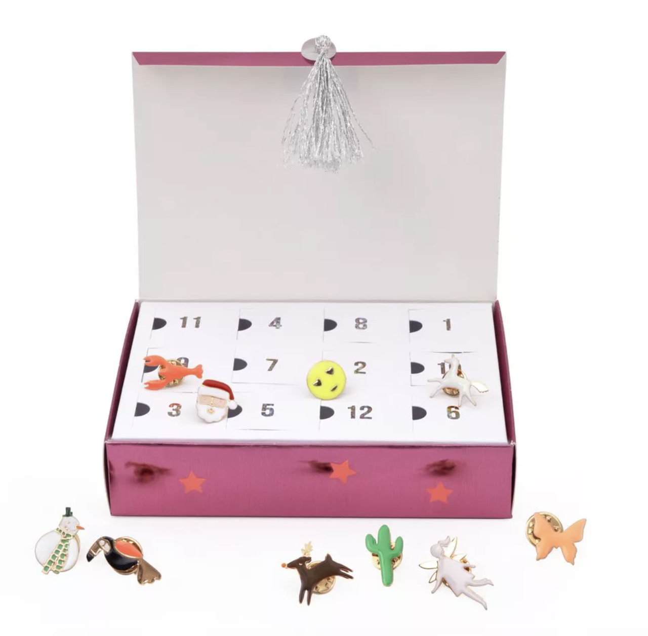 a pink box with 12 flaps each filled with an enamel pin