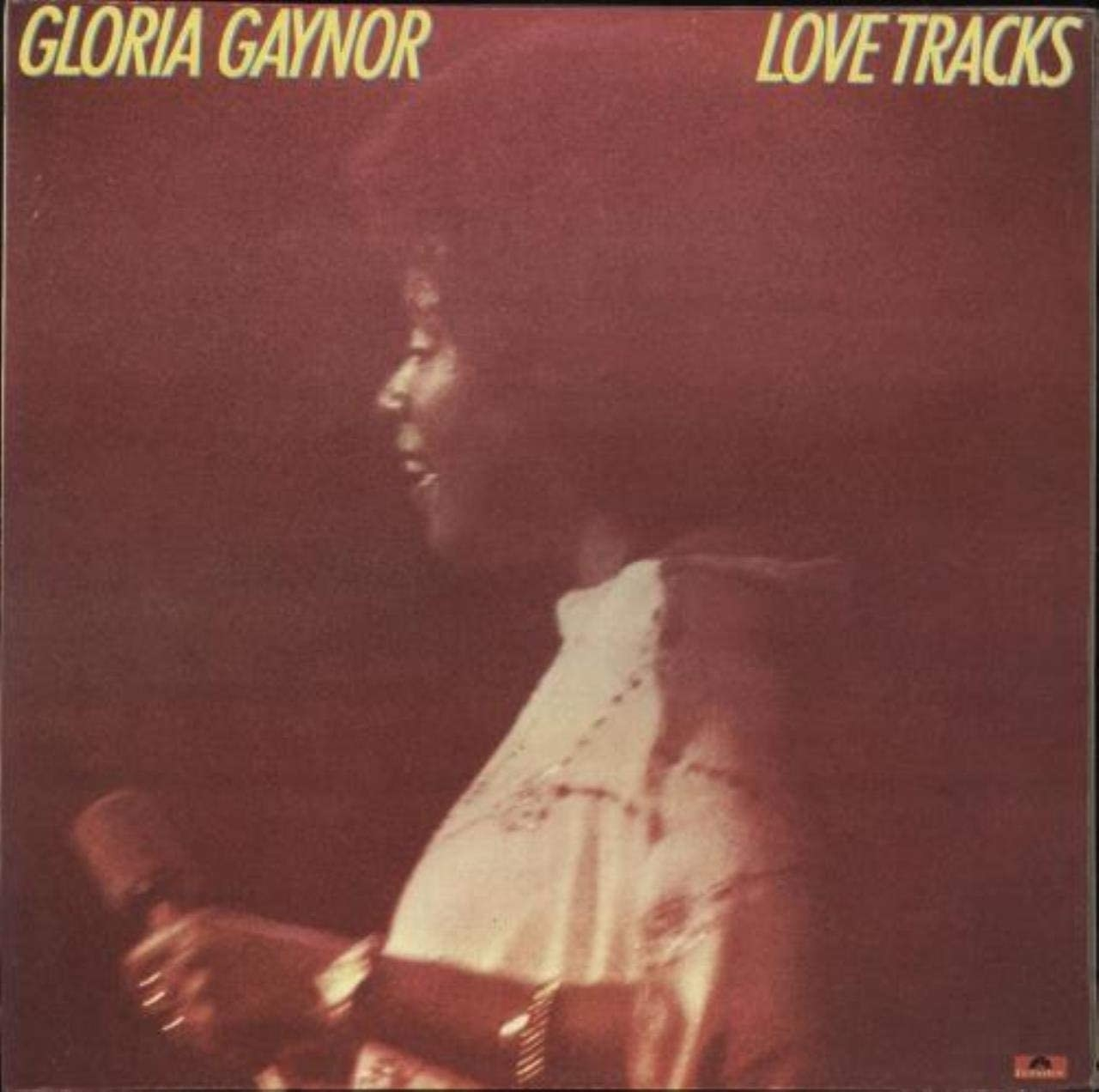 album cover of Love Tracks with Gloria Gaynor facing the side as she holds a mic