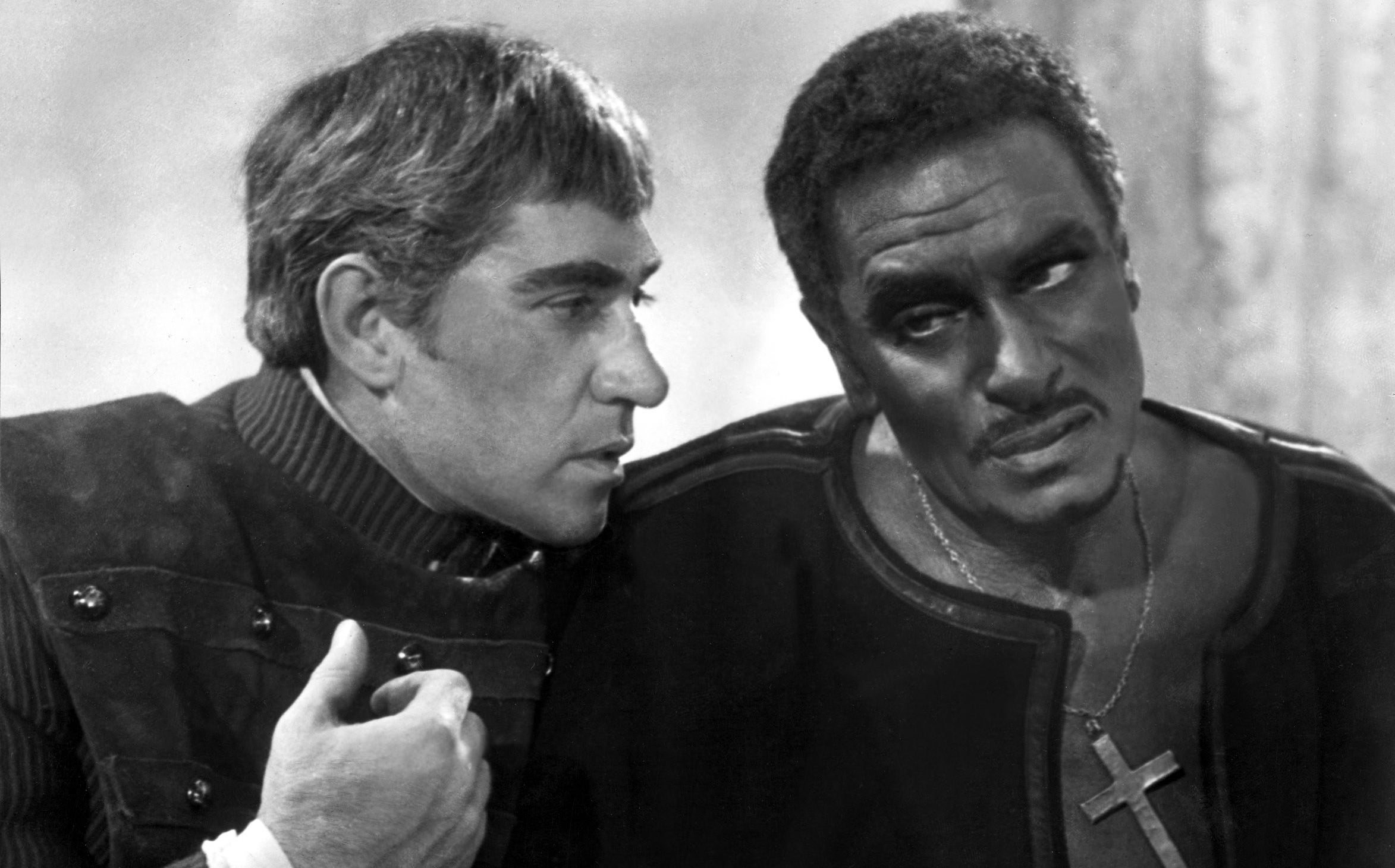 Laurence Olivier as Othello talking to Iago.