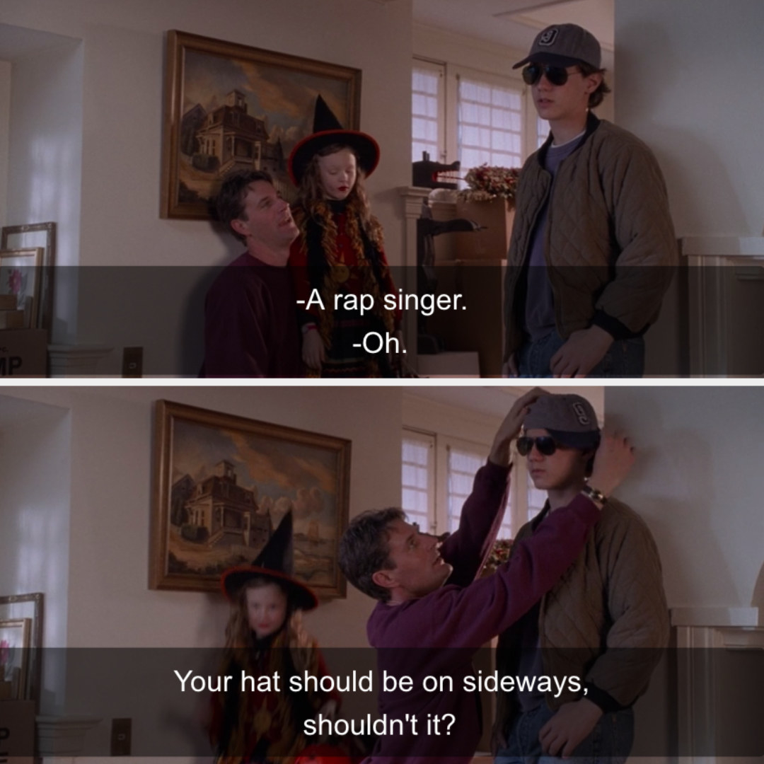 """Max's dad turning his hat sideways to help him better his """"rapper"""" costume."""