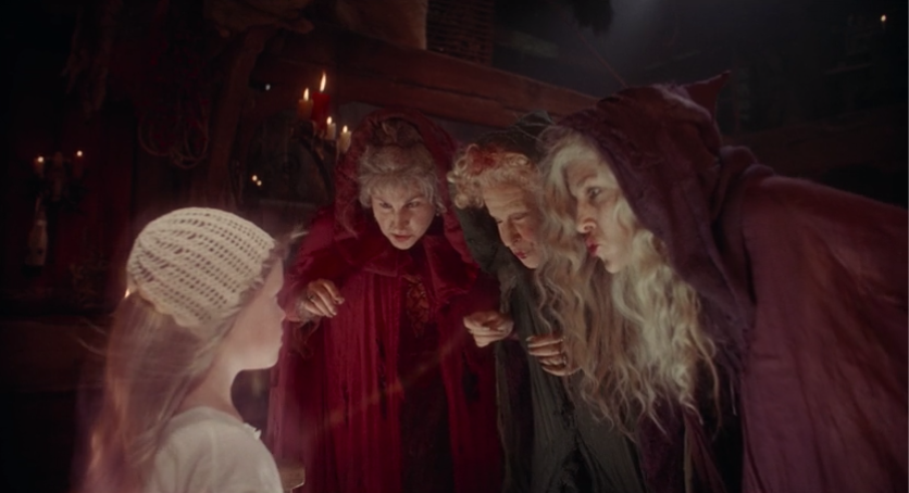 The Sanderson sisters sucking the soul from Emily Binx.