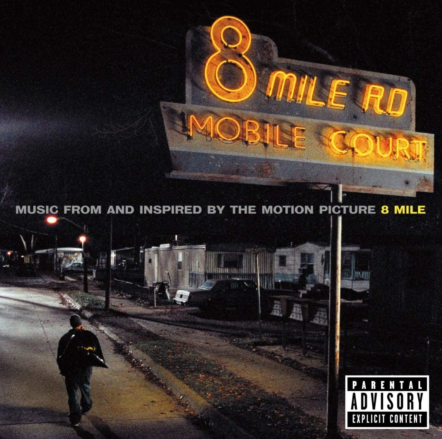 """album cover of 8 Mile showing Eminem walking down a road passing under a sign that reads, """"8 Mile Rd Mobile Court"""""""