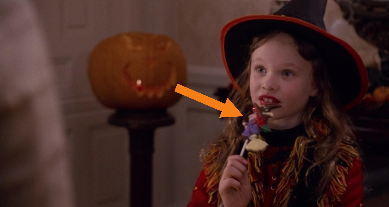 Dani eating a lollipop.