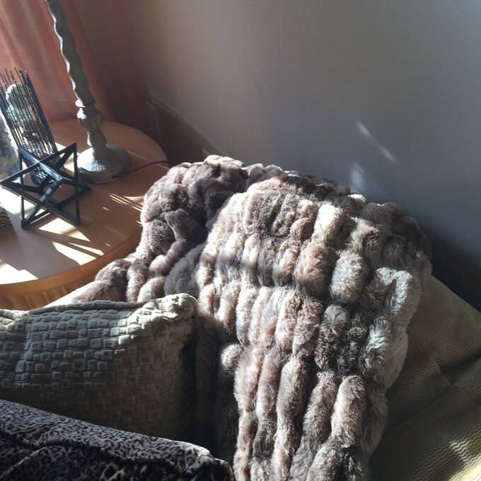 Reviewer's picture of the extra plush blanket in grey