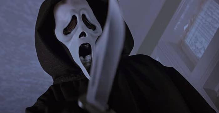 Scream mask man holding a knife