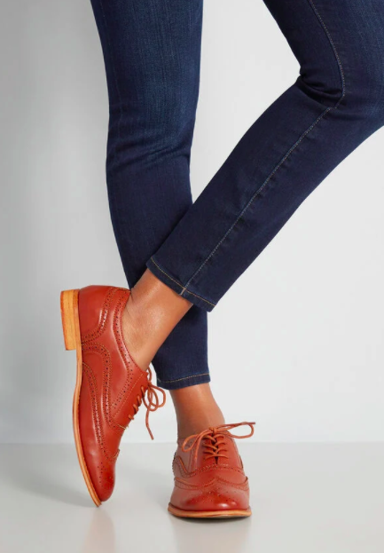 Model wears tan laced oxfords with blue denim