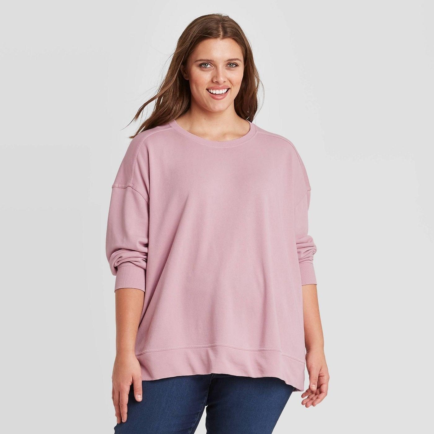 Model wearing the pink sweatshirt