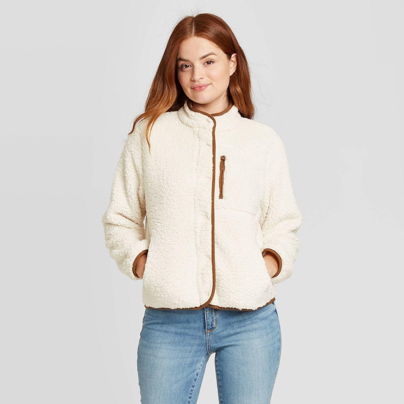 Model wearing the cream brown jacket