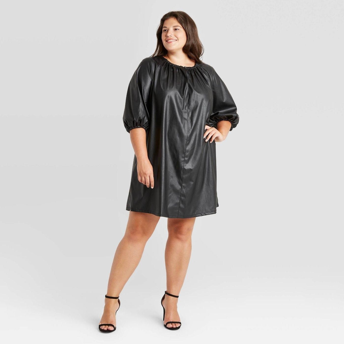 Model wearing the black dress