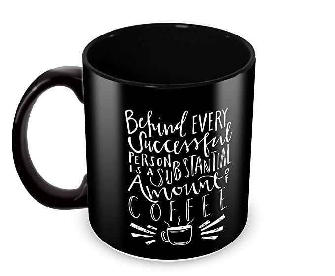 "Black mug with the words ""Behind every successful person is a substantial amount of coffee"" printed on it."
