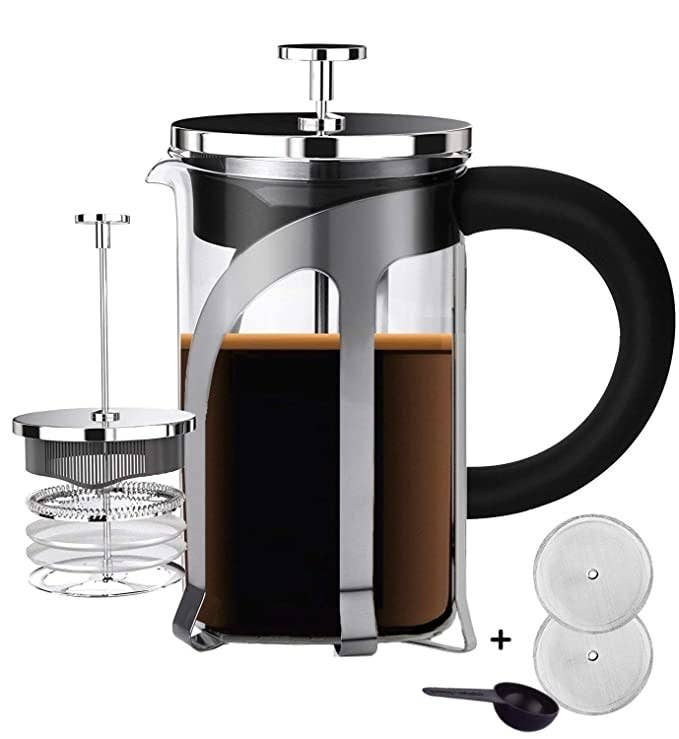 French press coffee maker with some coffee in it.
