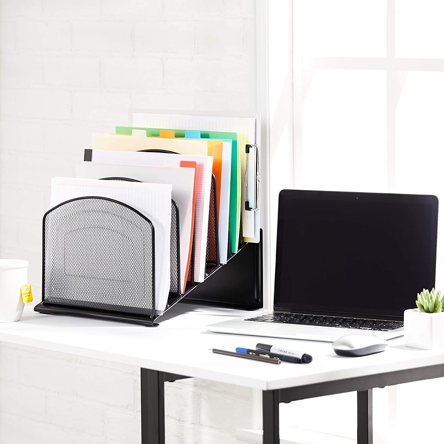 The mesh-sorter pictured on a work desk with files and documents in it.