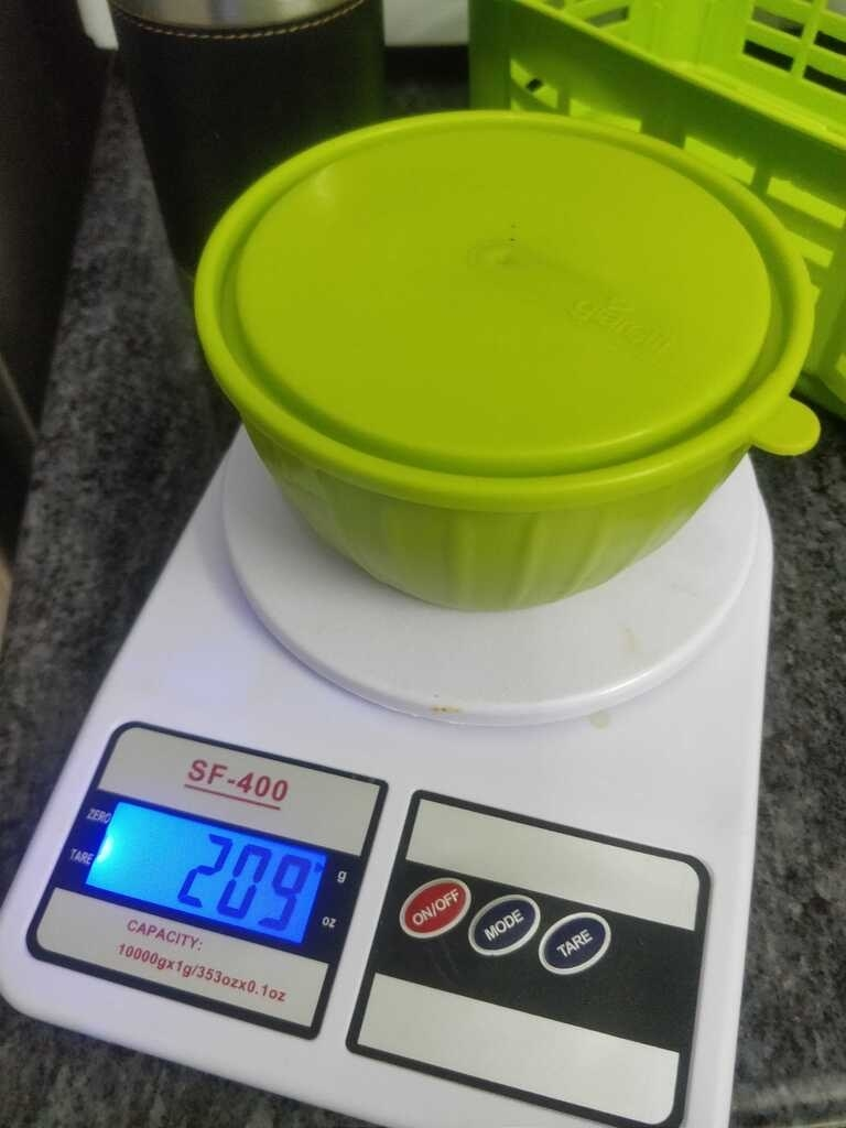 White digital weighing scale.