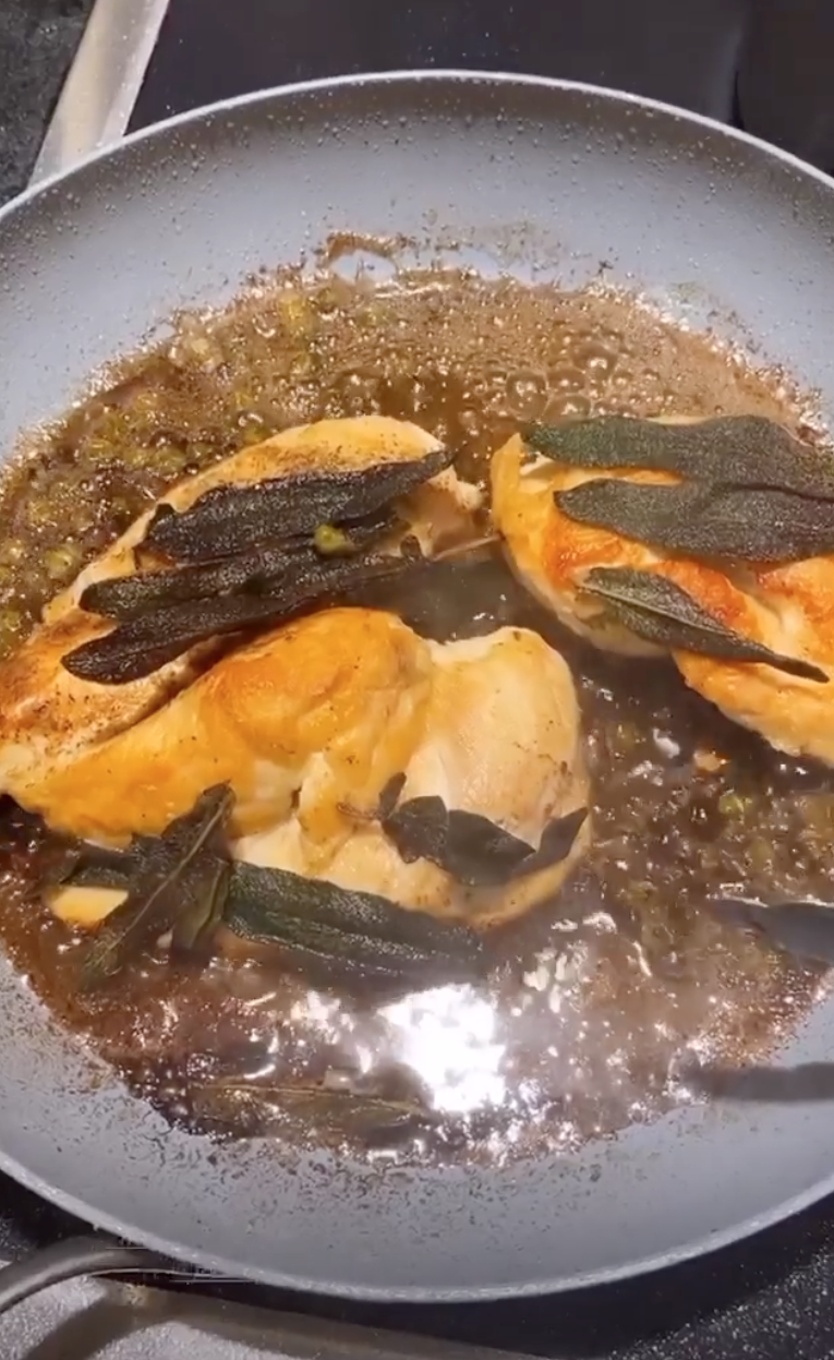 The chicken now cooks with the browned butter and sage