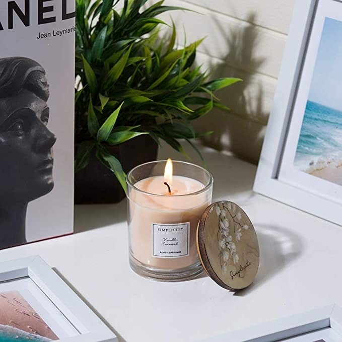 Scented candle in a glass jar.
