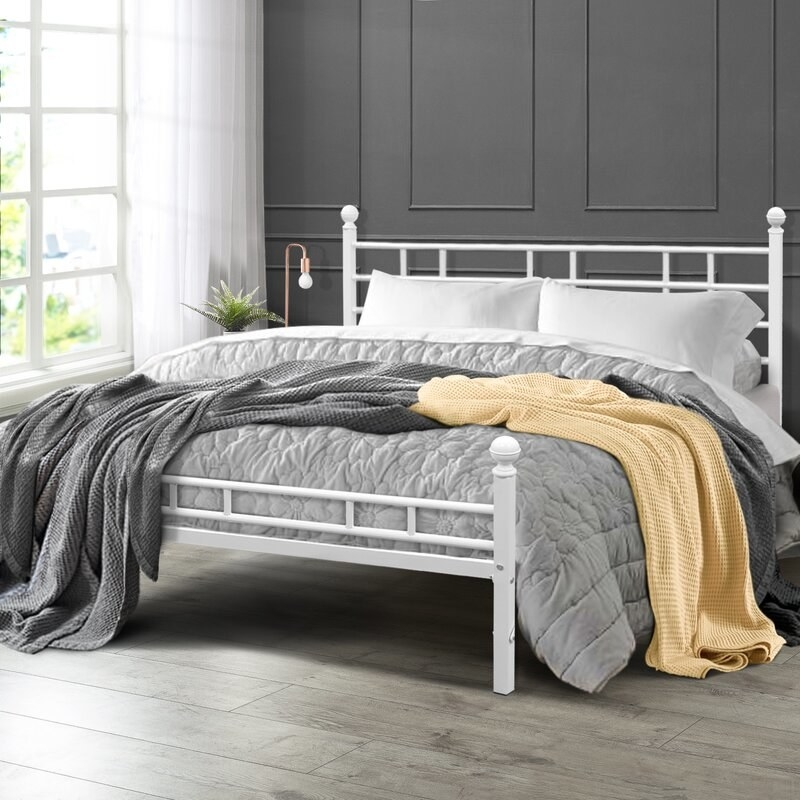 White steel bed frame with round corner knobs