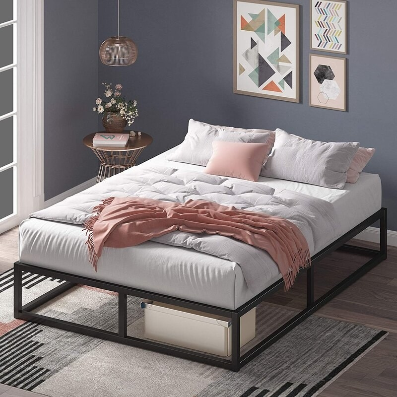 A black steel bed frame without headboard