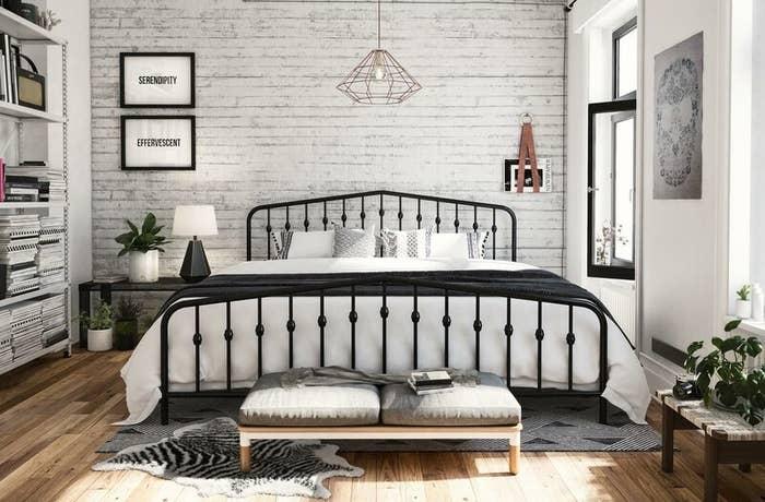 A black metal bed frame