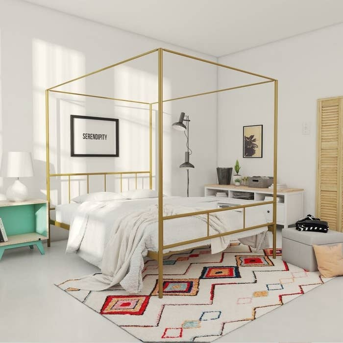 A gold canopy bed