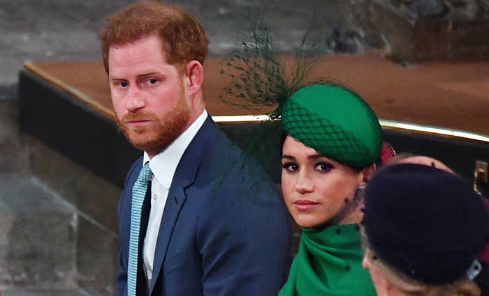 Prince Harry and Meghan Markle look sad during an event