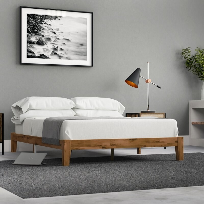 Natural wooden bed frame without headboard