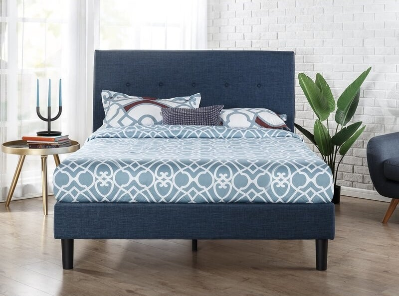 Navy blue bed frame with upholstered tufted headboard