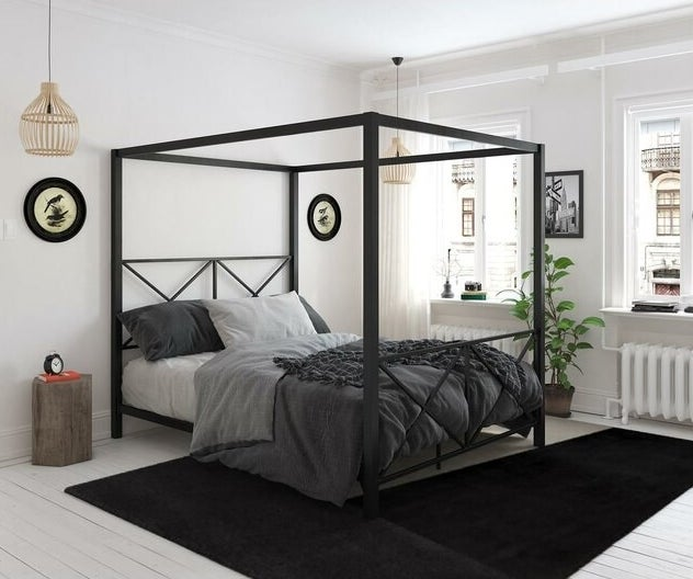 A black metal canopy bed