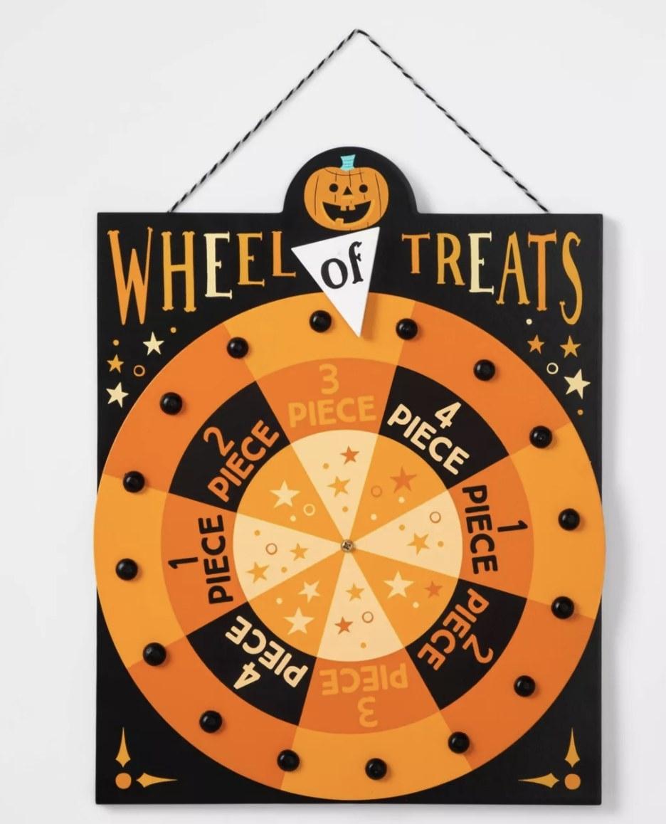 Wheel of treats spinning sign