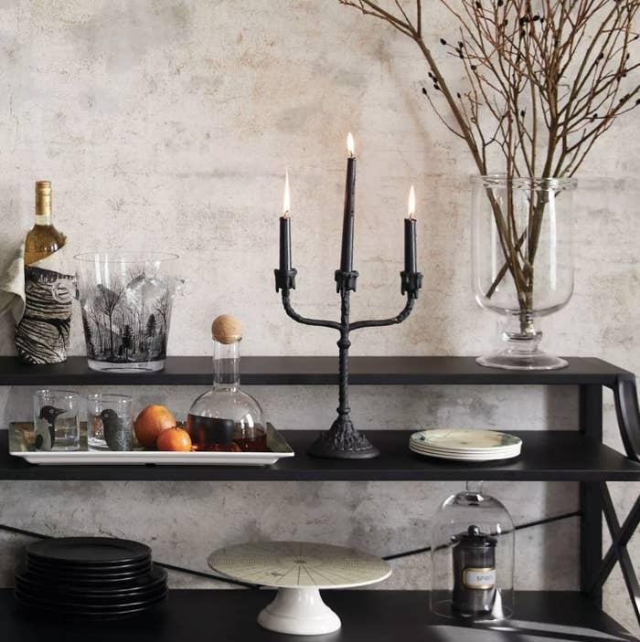 Macabre-labra dripping candelabra in black amongst a Halloween spread