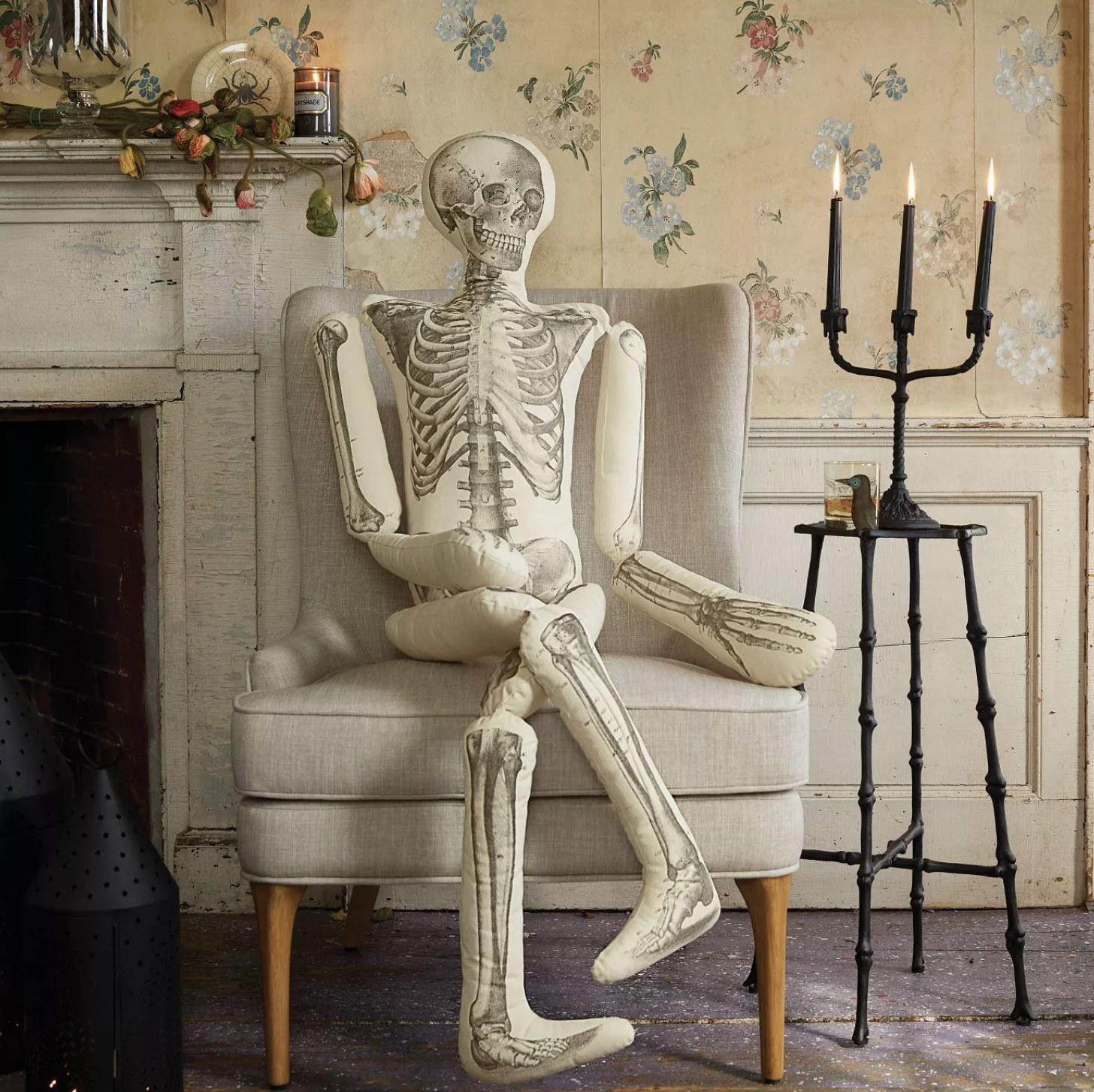 Skeleton throw pillow sits on armchair